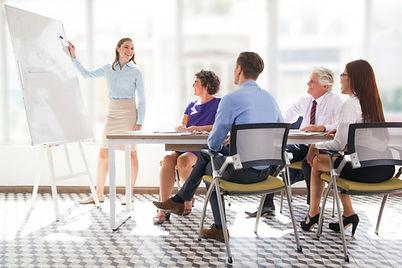 Cheerful business coach explaining strat
