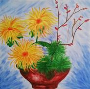 Drei Chrysantemen in Schale