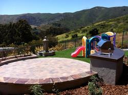 Family Friendly Backyard, Brisbane, CA-DPG.Design-paver-patio-natural-stone-cap