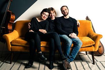 Trio in black shirts