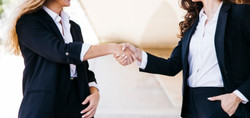 businesswomen-shaking-hands_23-214770252