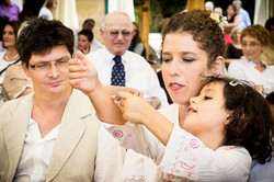 bride, groom and young girl