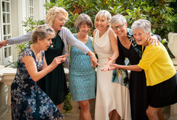 Bridal party looking at ring