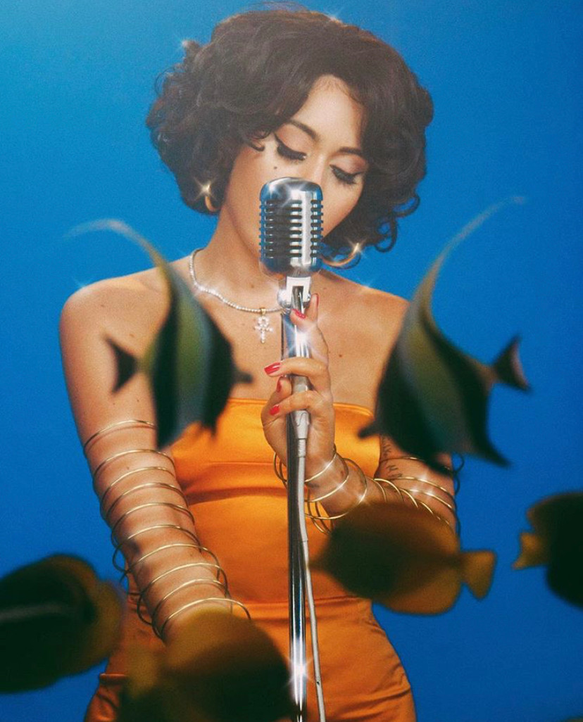Kali Uchis with fish by photographer, Coughs.