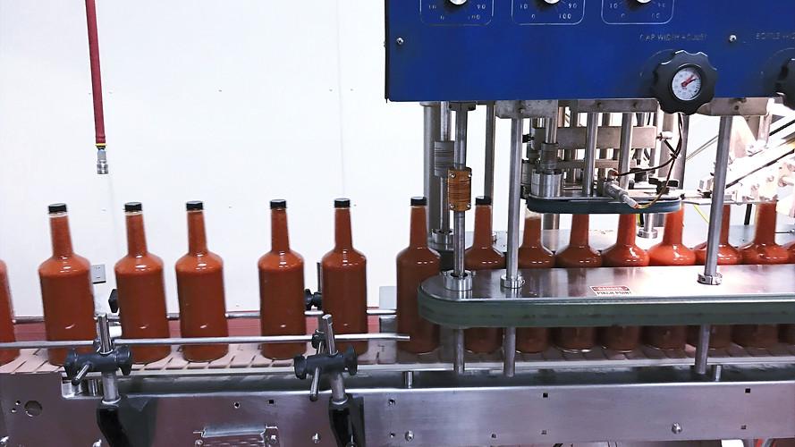 Maminka bottles in production