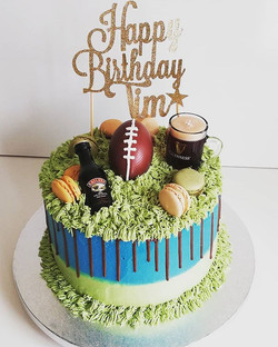 Rugby sport theme cake with Guinness and