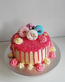 #pink doughnut dripcake__DM me to order
