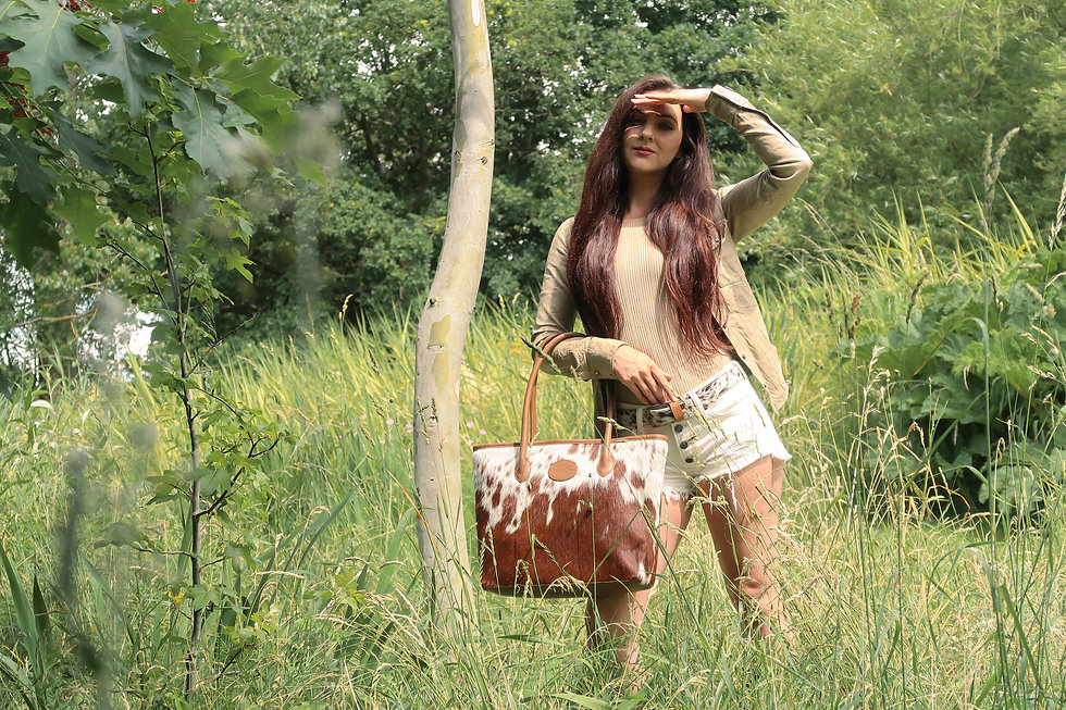 Charlotte in England modelling our Upton Cowhide Leather Handbag in the Summer Grass