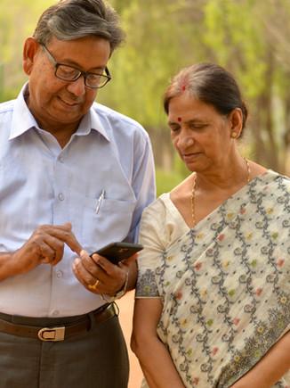 Senior Indian Bengali couple in park loo