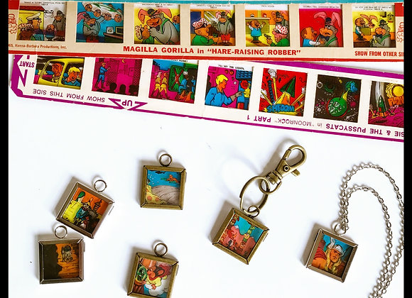 (5) Cartoon charm necklaces or keychains