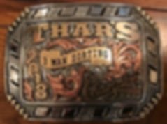 buck stitched trophy buckle, western buckle, laced edge with buck stitching