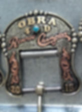 back cinch bucle with detailed scrolling and turquoise stones