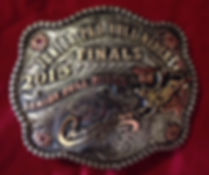 scalloped shaped buckle with scrools and stones for junior bull riders