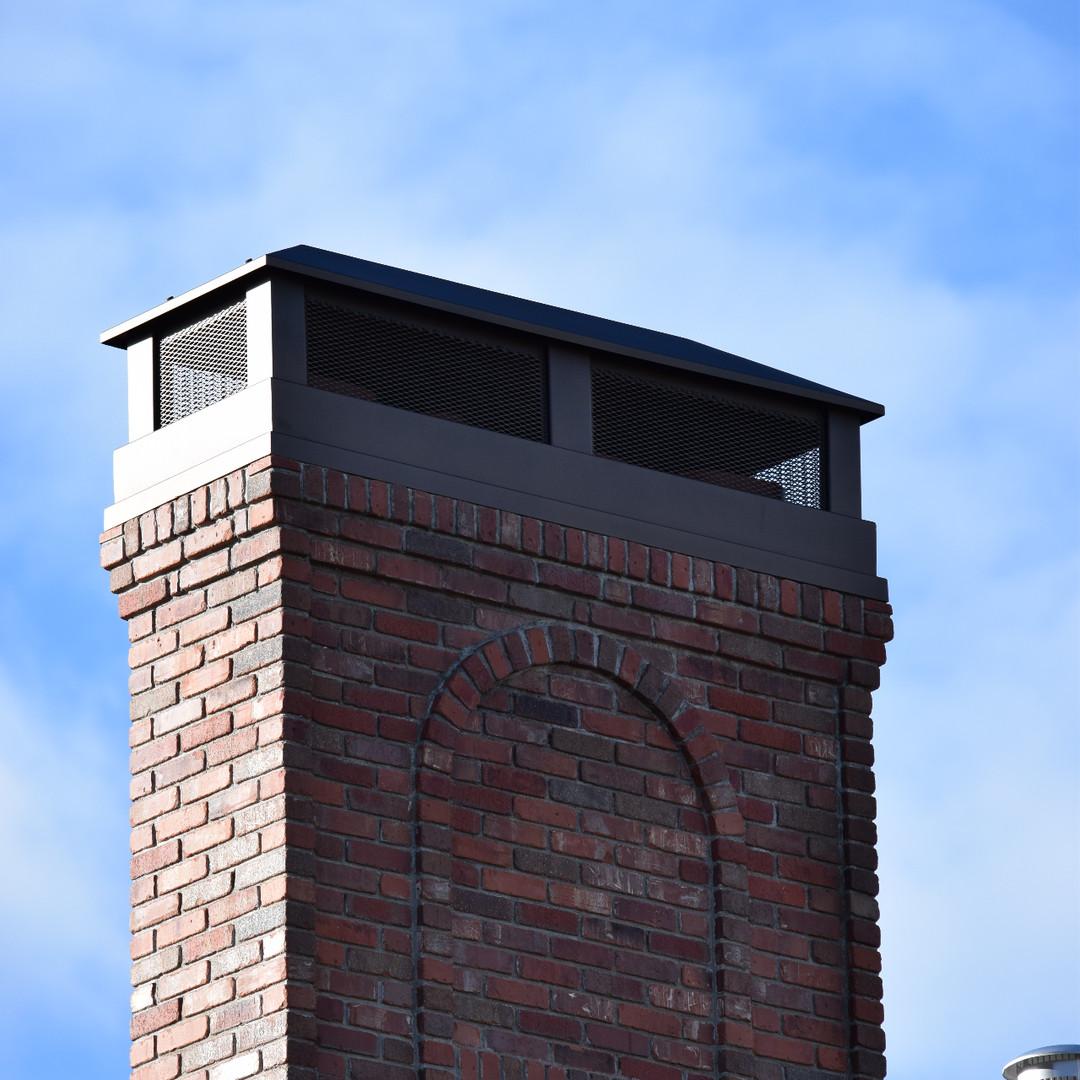Hip roof chimney cap
