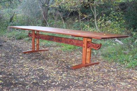 This table was made from the support beams to an old water tank.