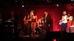 Mia Karter as Amy Winehouse