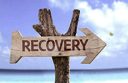Recovery wooden sign with a beach on bac