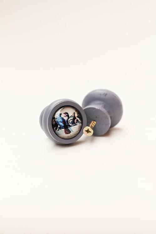 Doorknob bird on wire
