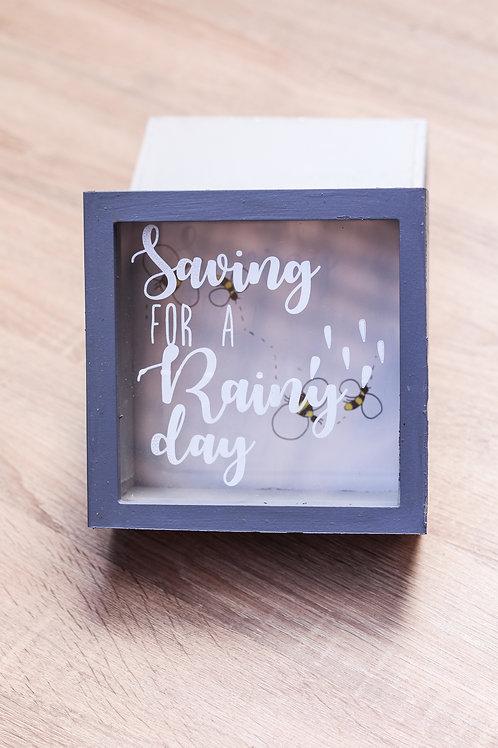Money BOX saving for a rainy day