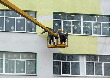 Dangerous job, painters working on mobil