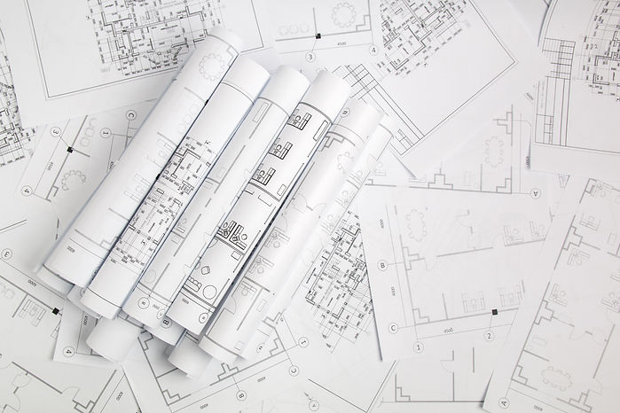 Paper architectural drawings and blueprint.jpg