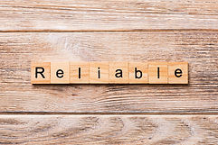 Reliable word written on wood block. Rel