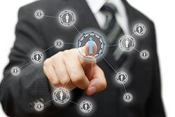 Businessman pressing virtual button on