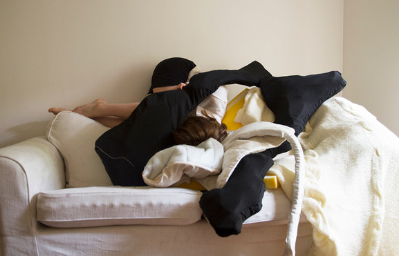 Digital photograph:  Sofa, foam, blanket, cotton fabric.