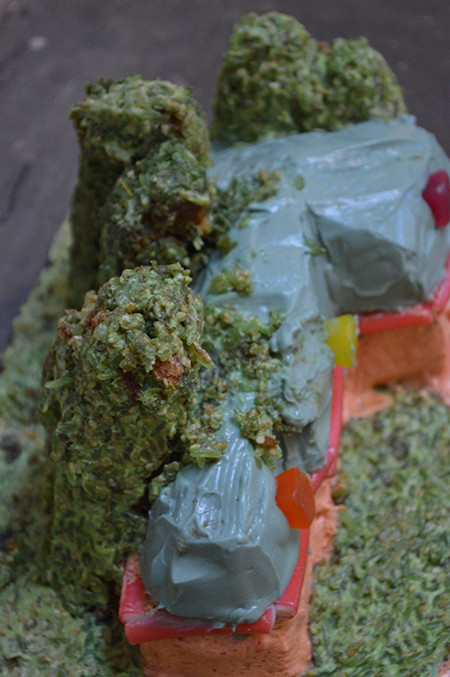 Installation detail:sponge cake with butter icing, food colouring, dry rice, jelly, weetabix, carboard and sweets.