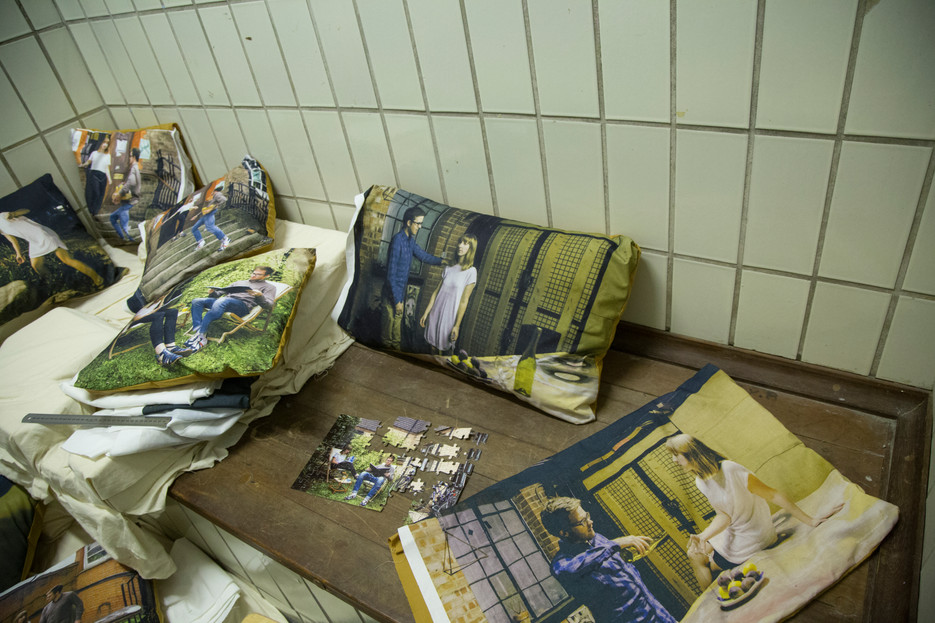 Installation shot: customised printed puzzle, printed fabric sewn as cushion covers, cushion inners.