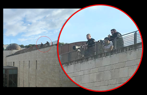 "Policemen surveilling the neighbourhood of Issawiya from the rooftop of ""Rabin Building"" in the Mount Scopus campus of The Hebrew University of Jerusalem"