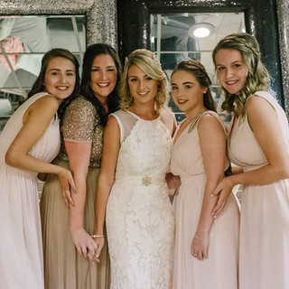 Bride with the bridal crew