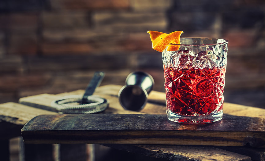 Cocktail Negroni on a old  wooden board.