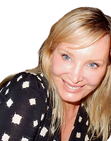 A smiling woman with blond hair in black top with white squares on it