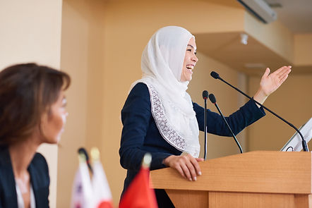 happy-young-female-speaker-in-hijab-laug