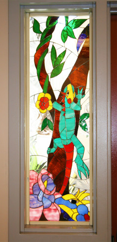 Stained glass mosaic lizard window at Ibarra Elementary School