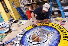 Mosaic tiger logo at Oak Park Elementary School