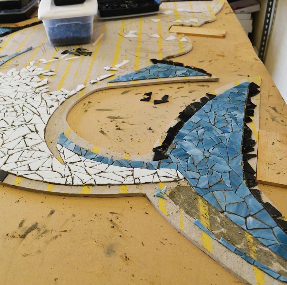 Mosaic shark logo at VIDA Academy