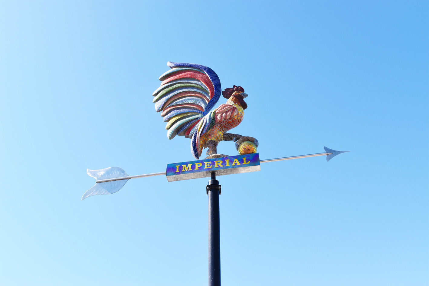 Mosaic rooster road sign in Imperial, California