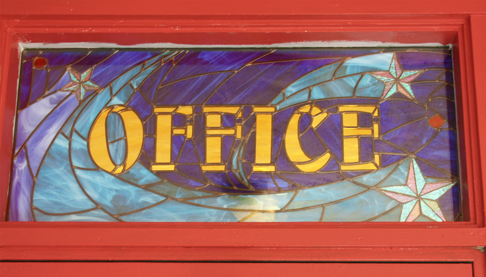Stained glass mosaic office sign at Hedrick Elementary School