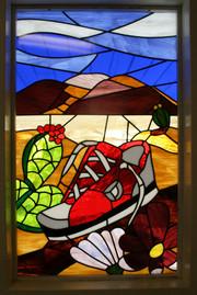 Stained glass sneaker mosaic window at Desert Garden Elementary School