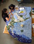 Students working on mosaic world at Hedrick Elementary School