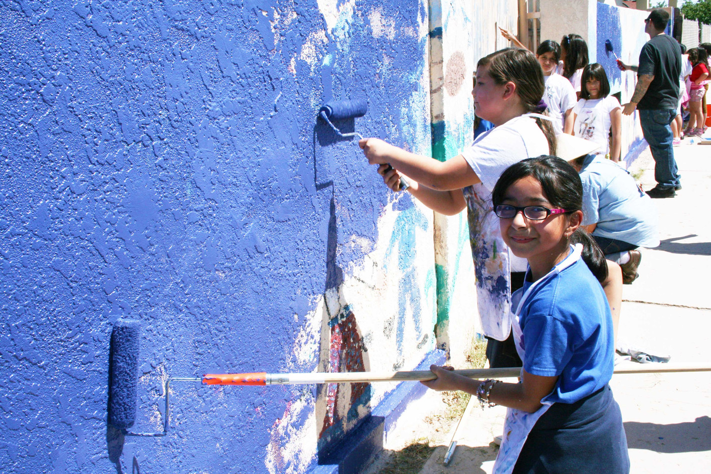 Students painting walls at Hedrick Elementary School
