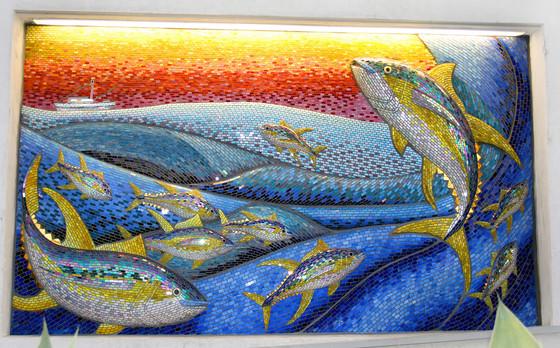 Colorful mosaic fish mural at Mercado del Barrio