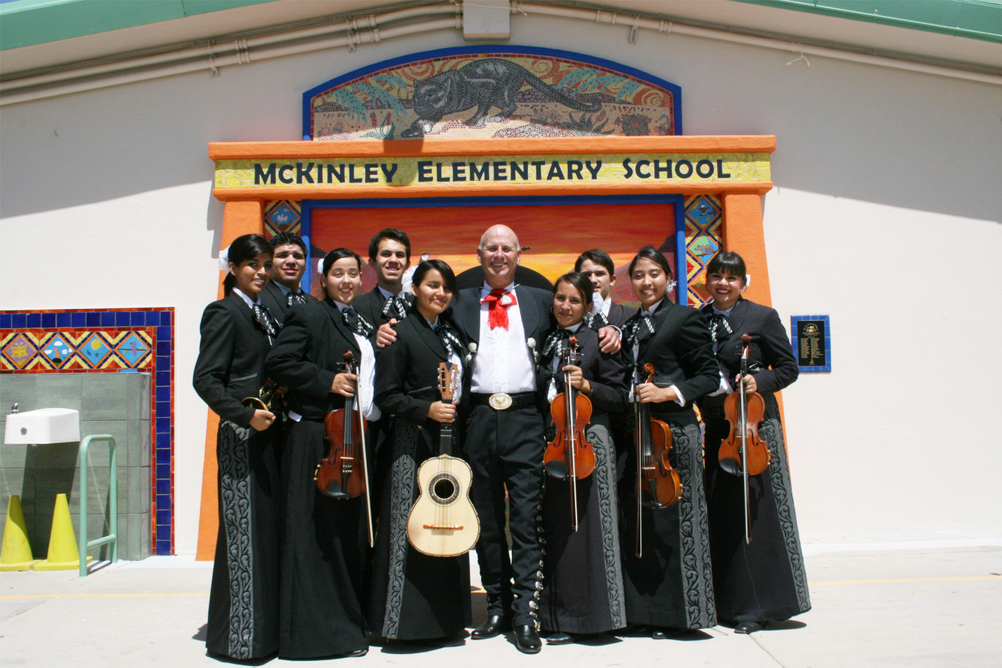Mariachi students with mosaic panther at McKinley Elementary School