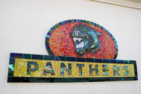 Mosaic panther logo at McKinley Elementary School