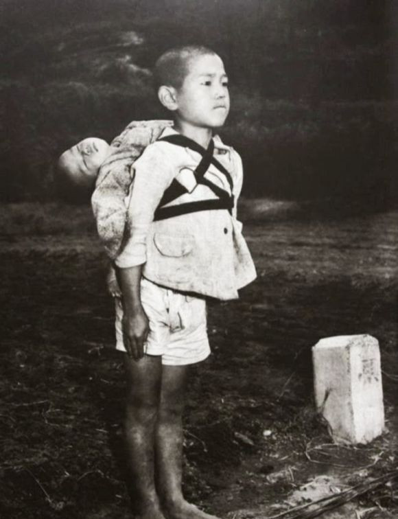 Japanese boy bringing his dead younger sibling to crematory