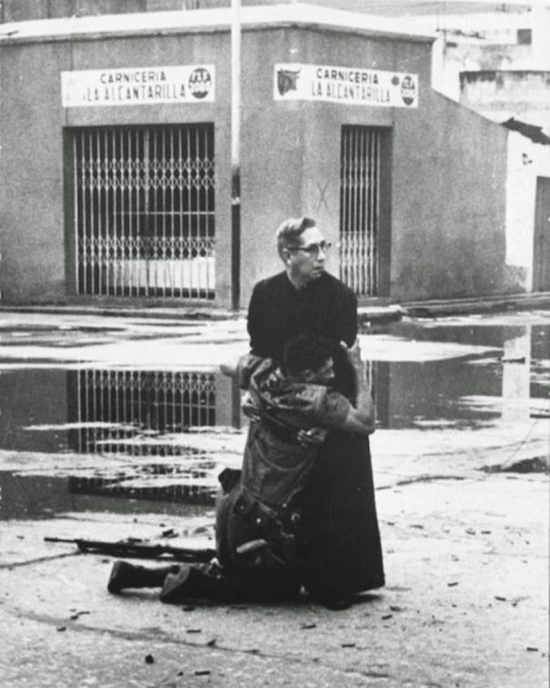Soldier dying in priest's arms