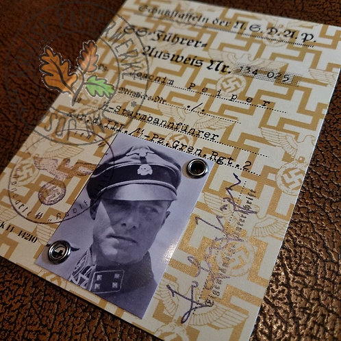 Joachim (Jochen) Peiper - reproduction of SS Ausweis with photo, signature and validity stamp.