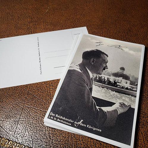 Adolf Hitler - signed photo postcard of the Führer as Reichskanzler on a boat on the lake Königssee near Berchtesgaden.